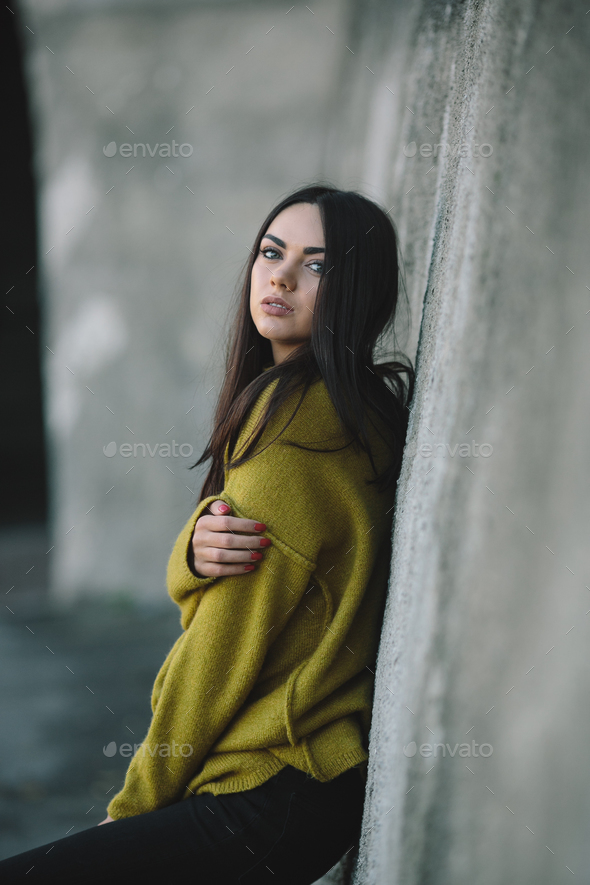 Fashion girl posing against wall - Stock Photo - Images