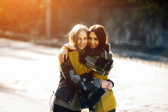 Fashion girls posing on the street - Stock Photo - Images