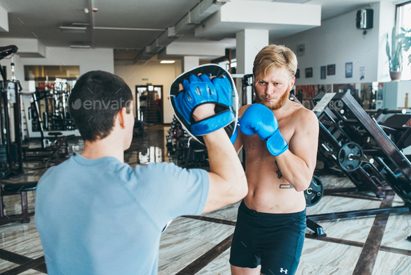 Men practicing boxing in gym - Stock Photo - Images