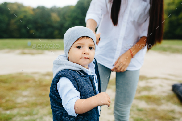 Mom with preteen child walking outdoor - Stock Photo - Images