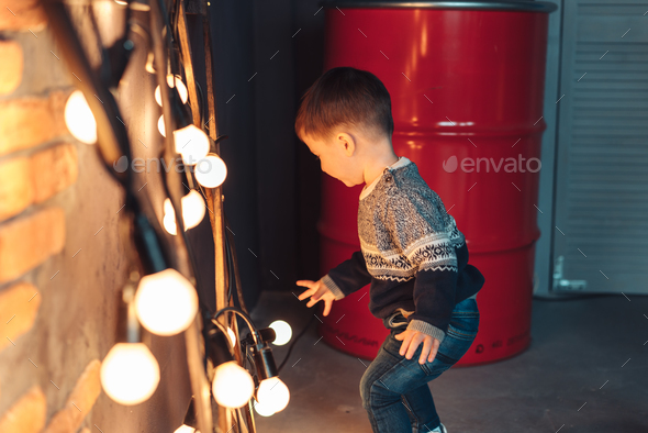 little boy plays with light bulbs - Stock Photo - Images