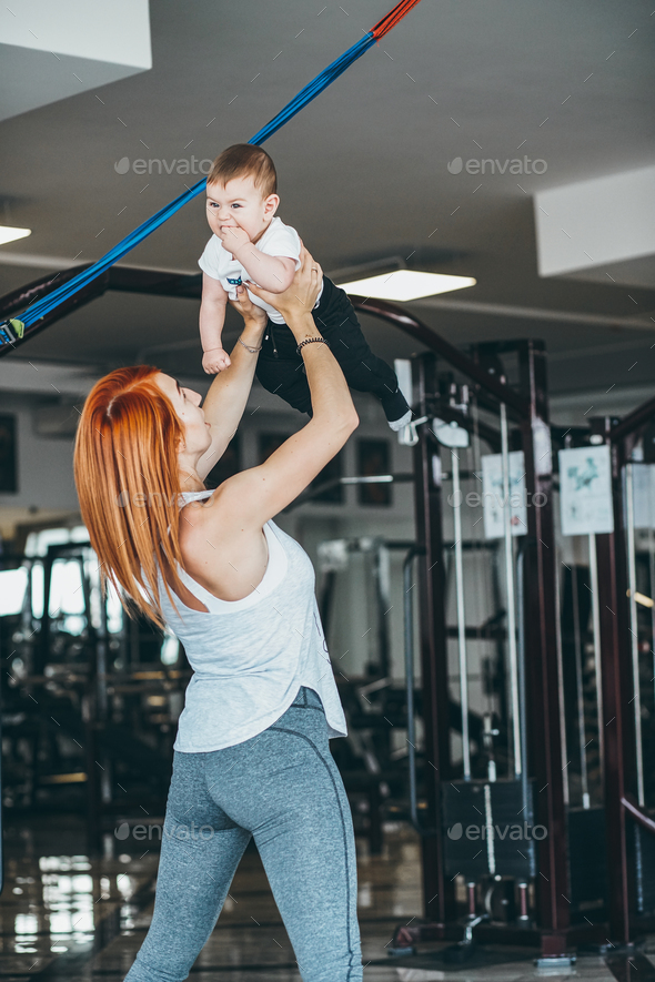 Young mother with her young son in the gym - Stock Photo - Images