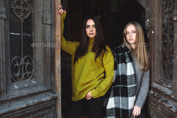 two beautiful women near the old doors - Stock Photo - Images