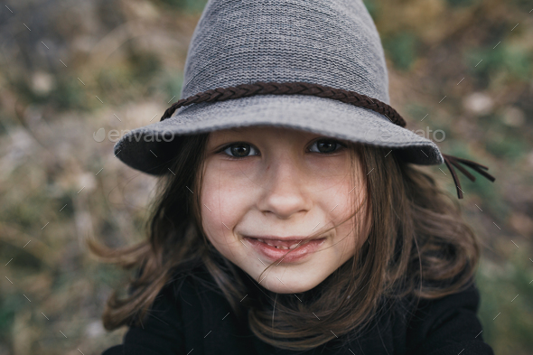 little girl in a black coat and hat - Stock Photo - Images