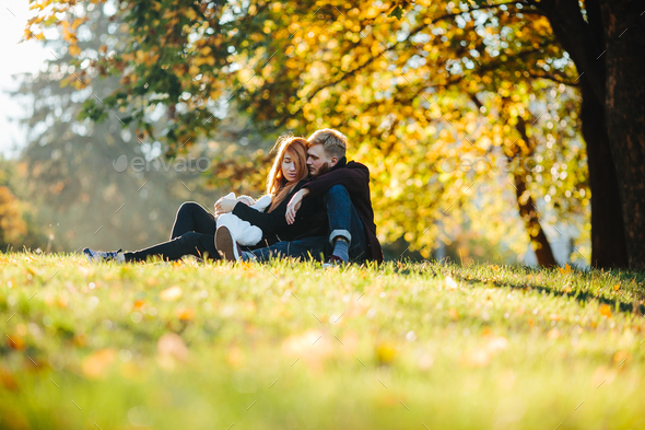 young family and newborn son in autumn park - Stock Photo - Images