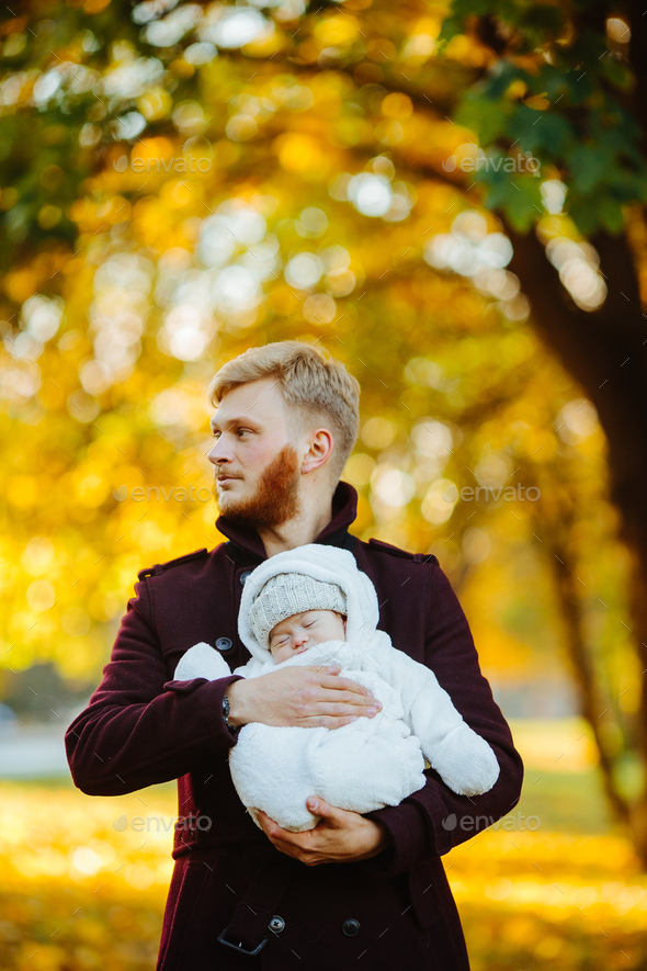 dad and newborn son in autumn park - Stock Photo - Images