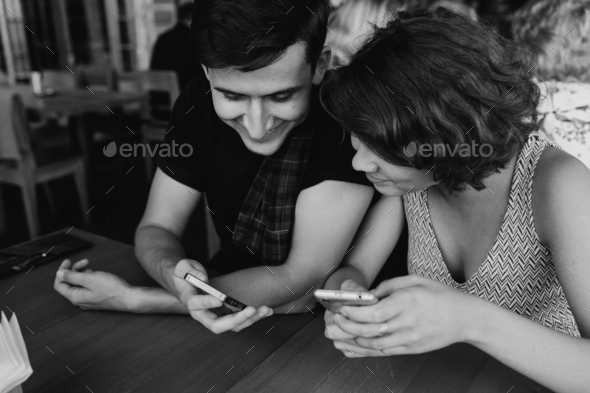 couple looking something in the smartphone - Stock Photo - Images