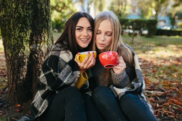 two beautiful in the park, posing for the camera - Stock Photo - Images