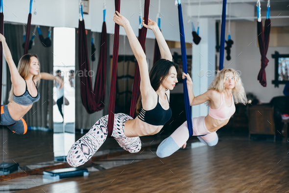 Young girls do aerial yoga in the gym - Stock Photo - Images