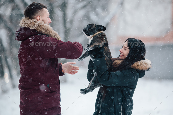 Young couple having fun on the snow - Stock Photo - Images