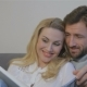 Couple Watches Photo Album at Home - VideoHive Item for Sale