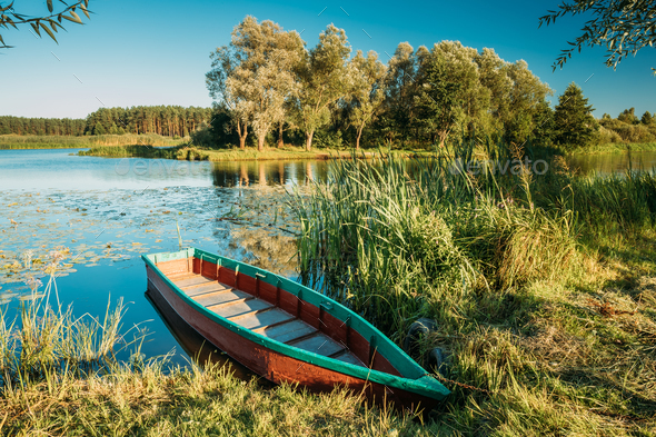 Lake Or River And Old Wooden Blue Rowing Fishing Boat At Beautif - Stock Photo - Images