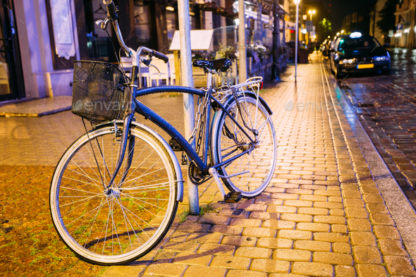 Bicycle Bike Parking On Street In Old Part European Town In Summ - Stock Photo - Images