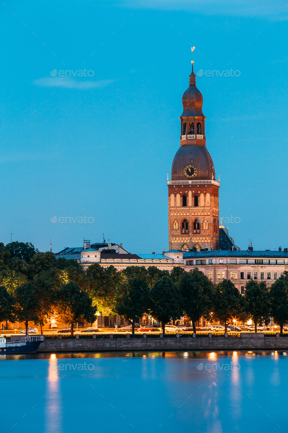 Riga Latvia. Tower Of Riga Dome Cathedral In Evening Illuminatio - Stock Photo - Images