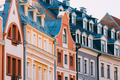 Riga Latvia. Mansard Tile Roof With Four Gable Fronted Dormer Wi