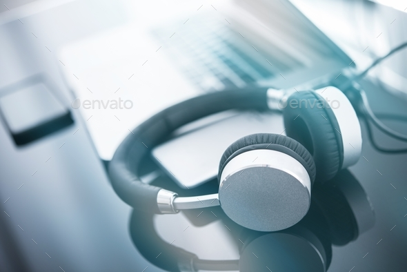 Headphones and the Computer - Stock Photo - Images