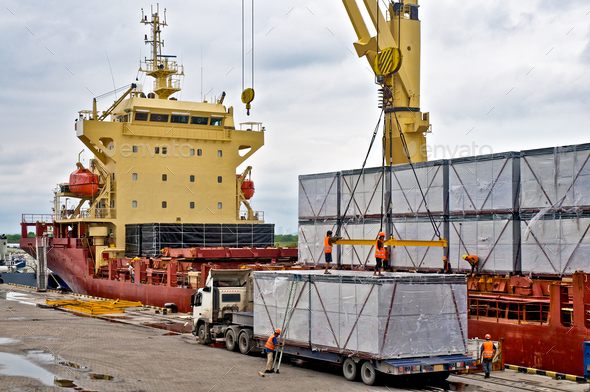 Loading cargo into the ship in harbor - Stock Photo - Images