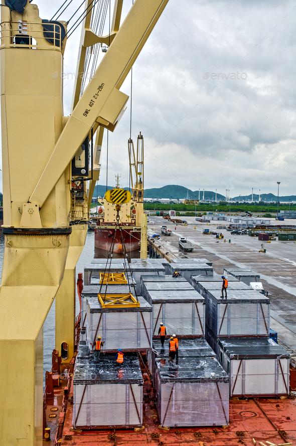 ฉargo loading  into the ship in port shipyard - Stock Photo - Images