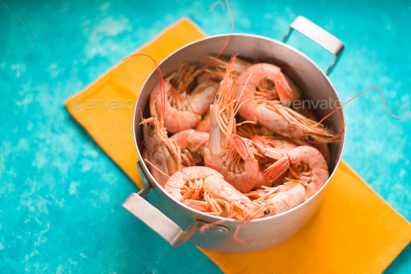 Casserole with shrimps on a bright yellow napkin - Stock Photo - Images