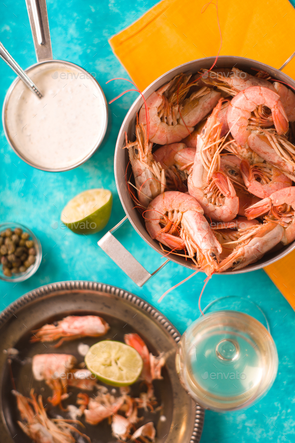 Shrimps in a saucepan on a yellow napkin, sauce, plate - Stock Photo - Images