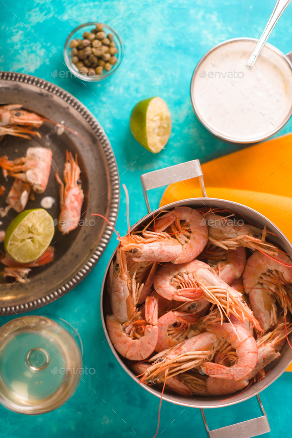 Casserole with shrimps, capers, lime, sauce on the table - Stock Photo - Images
