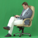 Male is Sitting with PC Tablet on Office Chair. Green Screen Studio - VideoHive Item for Sale