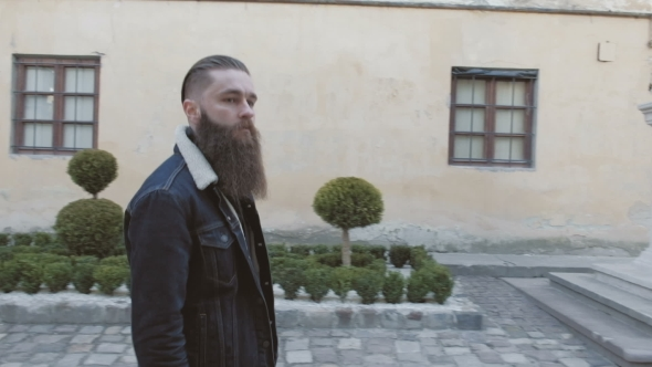 VideoHive Handsome Bearded Man Posing in the Street Brutal Hipster Portrait 19784257