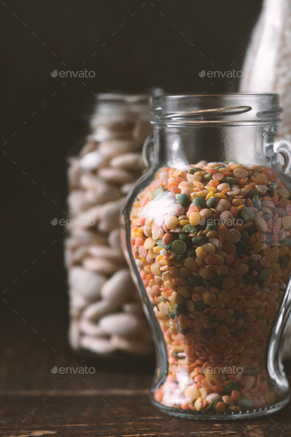 Lentils, rice, large white beans in glass jars healthy food - Stock Photo - Images