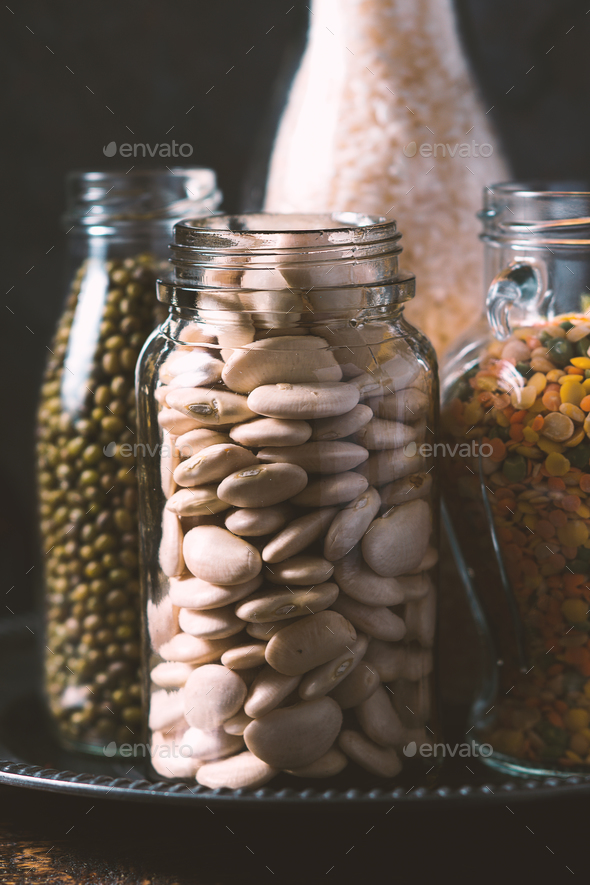 Rice, lentils, white beans in bottles side view - Stock Photo - Images
