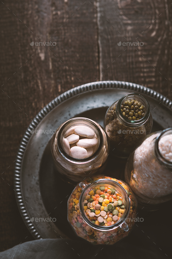 Beans, lentils, rice, bottled on a tin plate - Stock Photo - Images