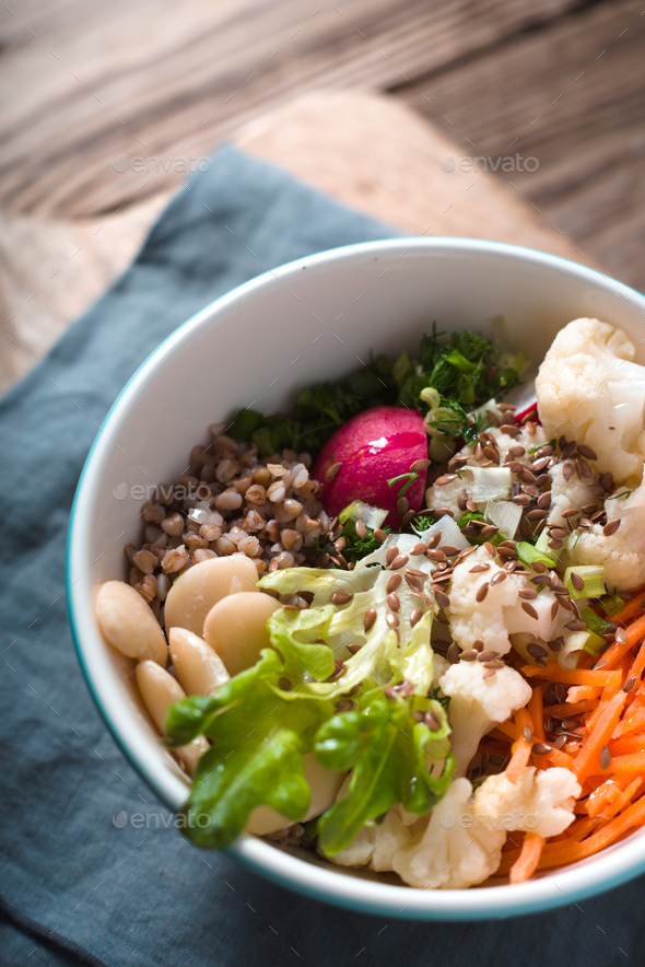 Vegetable salad with buckwheat in a ceramic bowl - Stock Photo - Images