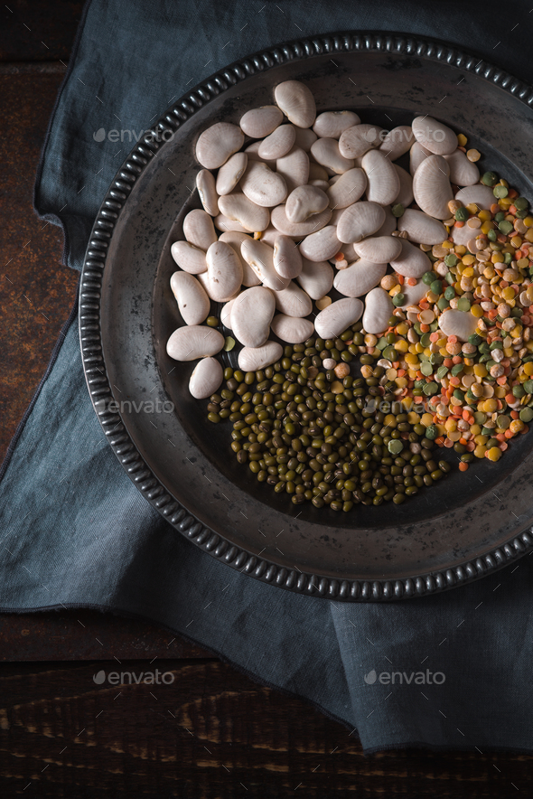 Tin plate with beans on gray napkin - Stock Photo - Images
