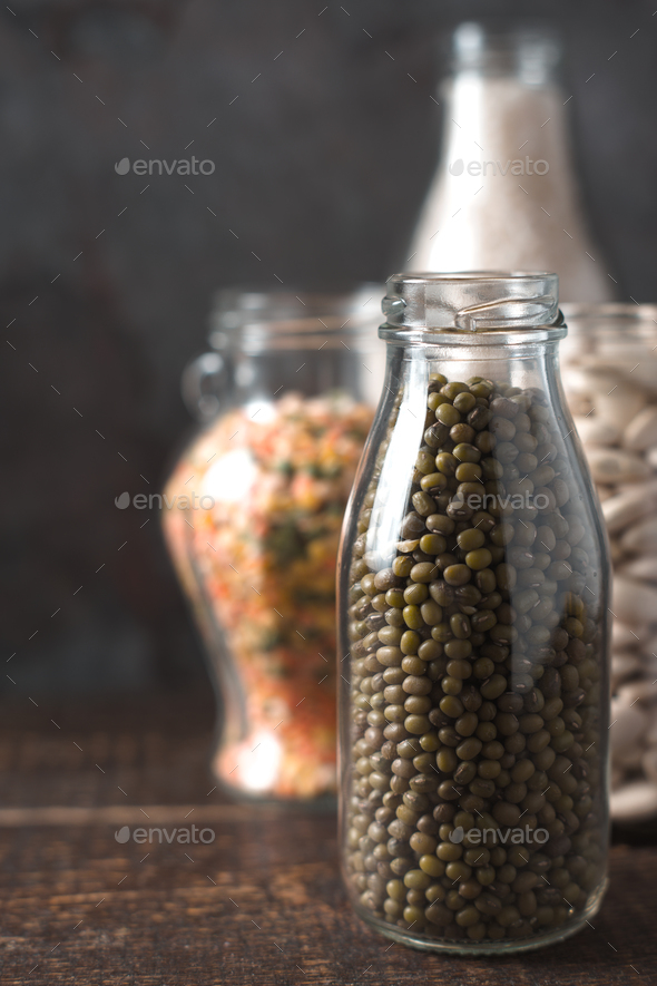 Banks with beans and lentils, rice in line - Stock Photo - Images