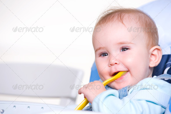 Beautiful happy toddler with spoon - Stock Photo - Images