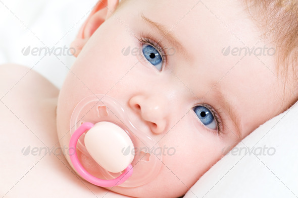face of a beautiful newborn girl with blue face - Stock Photo - Images