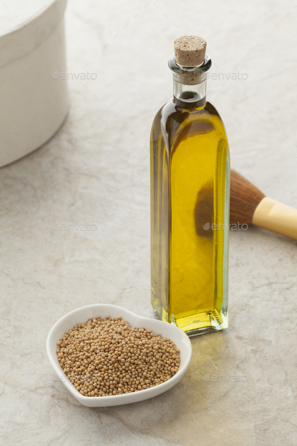 Bottle with mustard oil and seeds - Stock Photo - Images