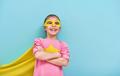child plays superhero
