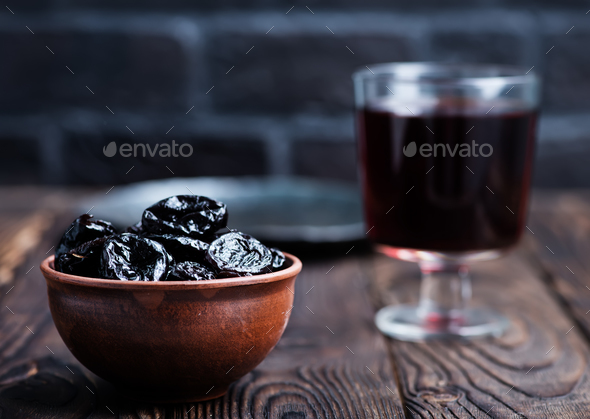drink and dry plums - Stock Photo - Images
