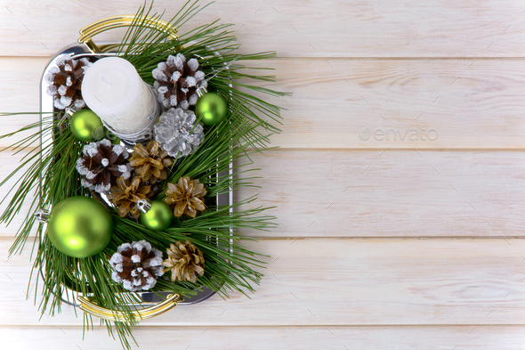 Christmas background with snowy pinecone decorated centerpiece - Stock Photo - Images