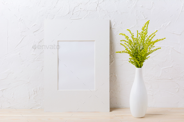 White mat frame mockup with ornamental grass in exquisite vase - Stock Photo - Images