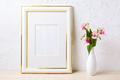 Gold decorated frame mockup with flower bouquet in elegant vase - PhotoDune Item for Sale