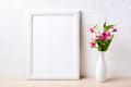 White frame mockup with pink flowers in elegant vase - PhotoDune Item for Sale