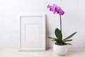 White frame mockup with purple orchid in flower pot - PhotoDune Item for Sale