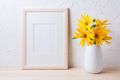Wooden white frame mockup with yellow rosinweed flowers - PhotoDune Item for Sale