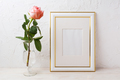 Gold decorated frame mockup with rose in exquisite glass vase - PhotoDune Item for Sale