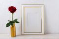 Frame mockup with burgundy red rose in golden vase - PhotoDune Item for Sale