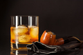 Scotch drink glass and smoking pipe on black background - PhotoDune Item for Sale