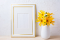Gold decorated frame mockup with yellow rosinweed flowers - PhotoDune Item for Sale
