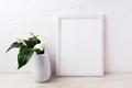 White frame mockup with euxaris flower in vase - PhotoDune Item for Sale