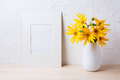 White mat frame mockup with yellow rosinweed flowers in pitcher - PhotoDune Item for Sale